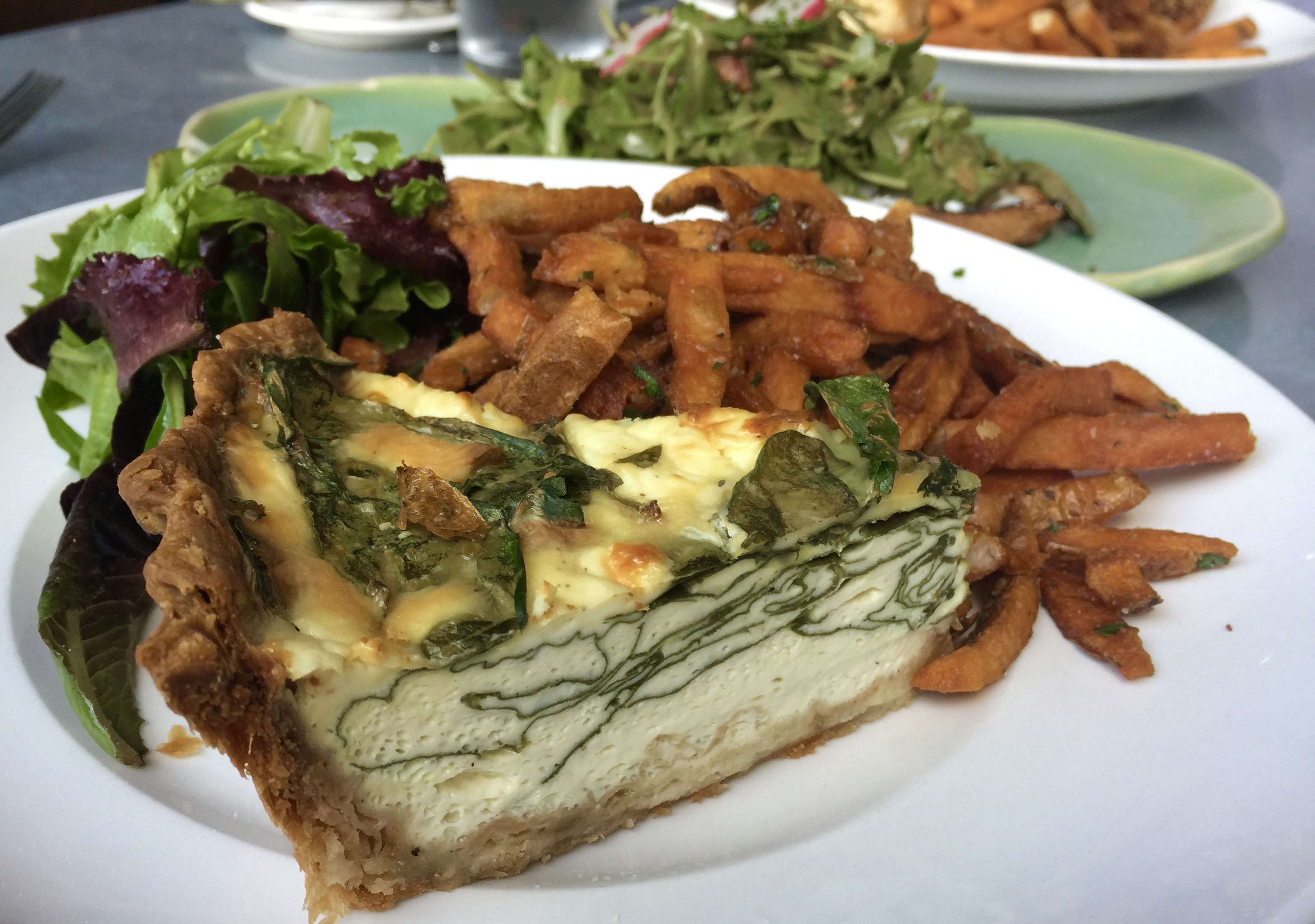 Brunch quiche, fries, and salad from Josephine's. Photo by Melody Pittman.