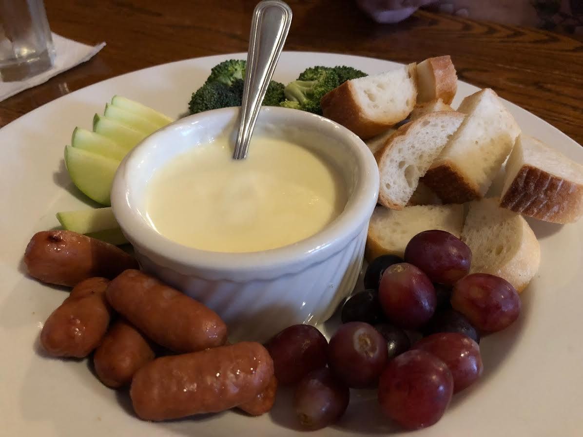 The appetizer fondue is a must from Woody's Library Restaurant!