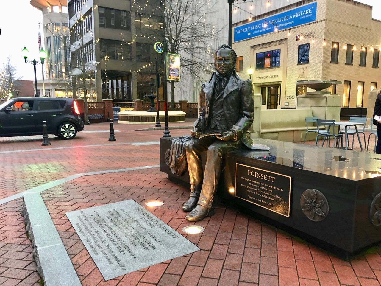 Downtown Greenville has several educational statues around town including this one of Joel Poinsett, who brought the poinsettia flower to the United States from Mexico.